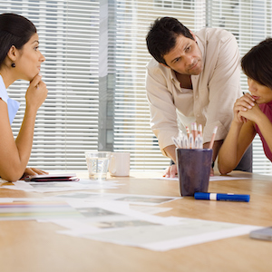 Businesspeople sitting at conference table during meeting